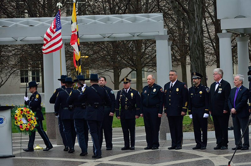 The University of Maryland Police Department Honor Guard marches past members of IACLEA's Board of Directors.