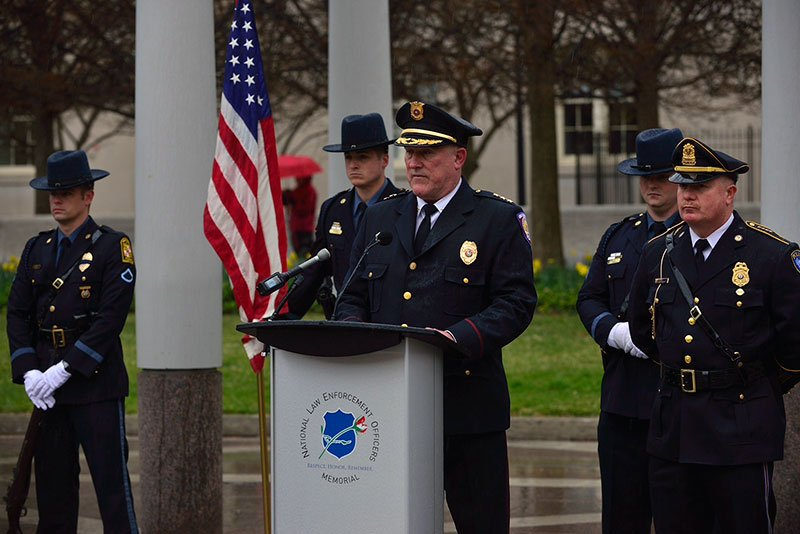 Chief Michael Ragan (at podium) with President-elect David Bousquet (far right) read the names of the 43 fallen campus public safety officers honored at the national memorial.