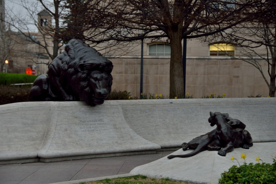 "Lions guard the wall where the names of more than 20,000 fallen officers are inscribed. ""The wicked flee when no man pursueth. But the righteous are bold as a lion."""